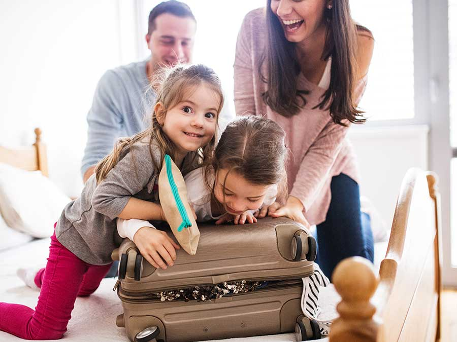 Family packing bags for a cruise
