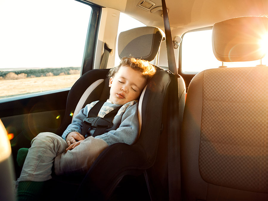 Toddler sleeping in a car seat