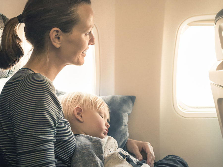 Baby sleeping on a flight