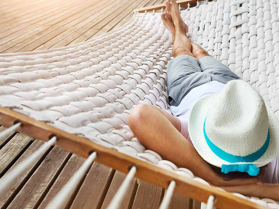 Woman relaxing on a hammock